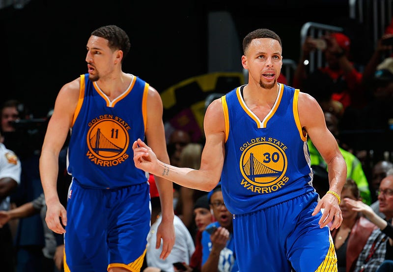 Klay Thompson and Stephen Curry of the Golden State WarriorsKevin C. Cox/Getty Images