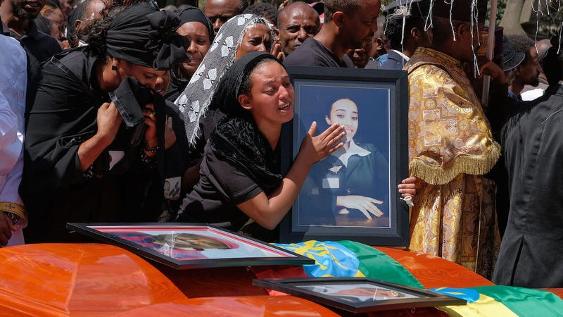 A woman mourns the death of her loved one at a memorial service for those who died on Ethiopian Airways Flight 302
