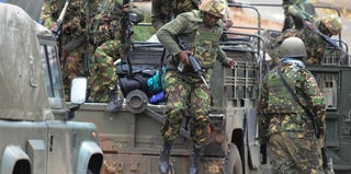 Kenyan Defense Forces arrive at the Westgate Mall in Nairobi, Kenya, where militant attacks occurred. (Simon Maina/Getty Images)