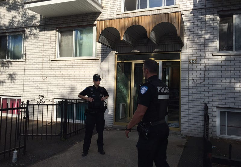 Montreal police on June 21, 2017, guard the front of the building where Amor Ftouhi, who is suspected of stabbing a Michigan airport police officer, lived before traveling to the U.S. earlier this month. (Julien Besset/AFP/Getty Images)