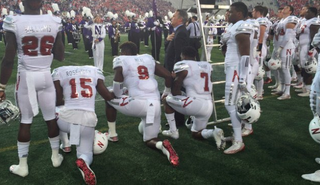Nebraska players kneel in protest during the game Sept. 24, 2016.KFYR Screenshot