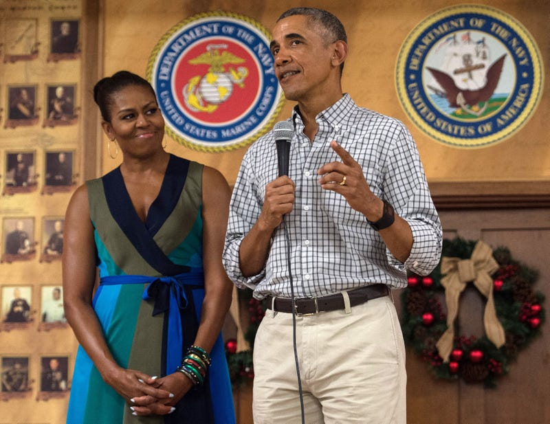 President Barack Obama addresses troops with first lady Michelle Obama at Marine Corps Base Hawaii in Kailua on Dec. 25, 2016. NICHOLAS KAMM/AFP/Getty Images