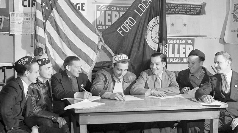 Seven of the eight UAW members whose discharge by the Ford Motor Company precipitated the River Rouge plant strike, met on April 7, 1941, at union headquarters.