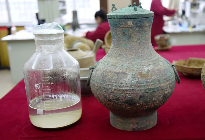 "The so-called ""elixir of immortality"" and the bronze pot within which is was found."