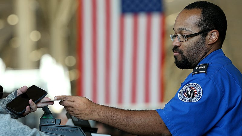 A TSA agent checks in passengers. Photo: Getty