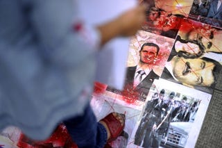Activists protest against Syrian dictator Bashar al-Assad. (Getty Images)