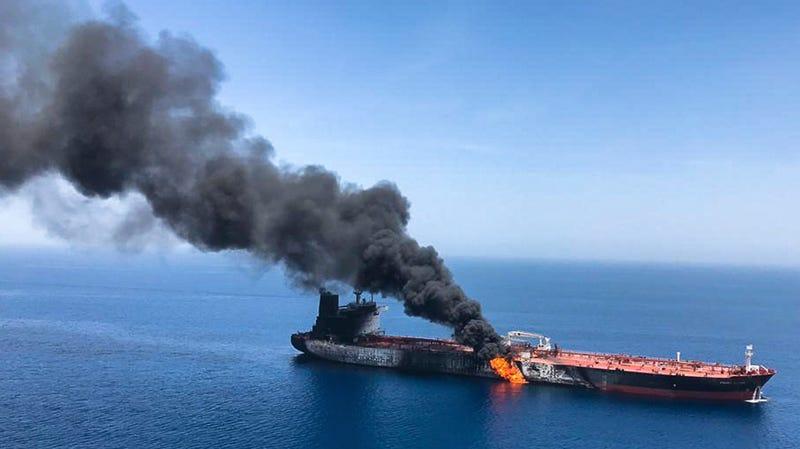 An oil tanker burning near the Strait of Hormuz, June 13, 2019.