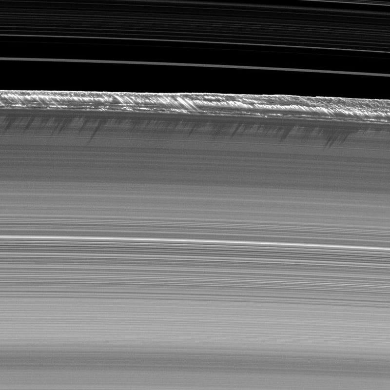 Illustration for article titled Two-mile-high structures rising on Saturn's rings