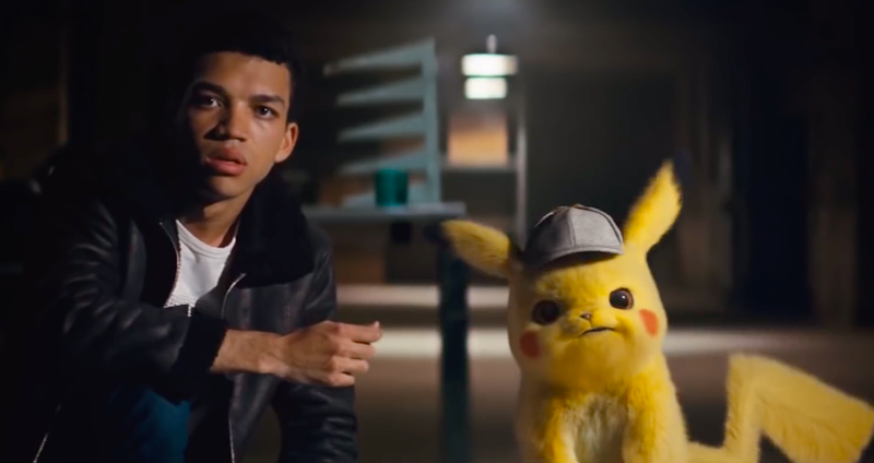 Justice Smith as Tim Goodman and his surly friend Pikachu.