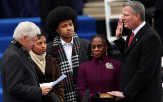 Bill de Blasio is sworn in by former President Bill Clinton as his family watches.Spencer Platt/Getty Images