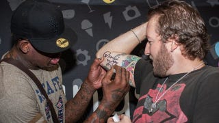 Illustration for article titled A Fan At The Dennis Rodman Viewing Party Experience Got Rodman's Autograph Tattooed On His Arm