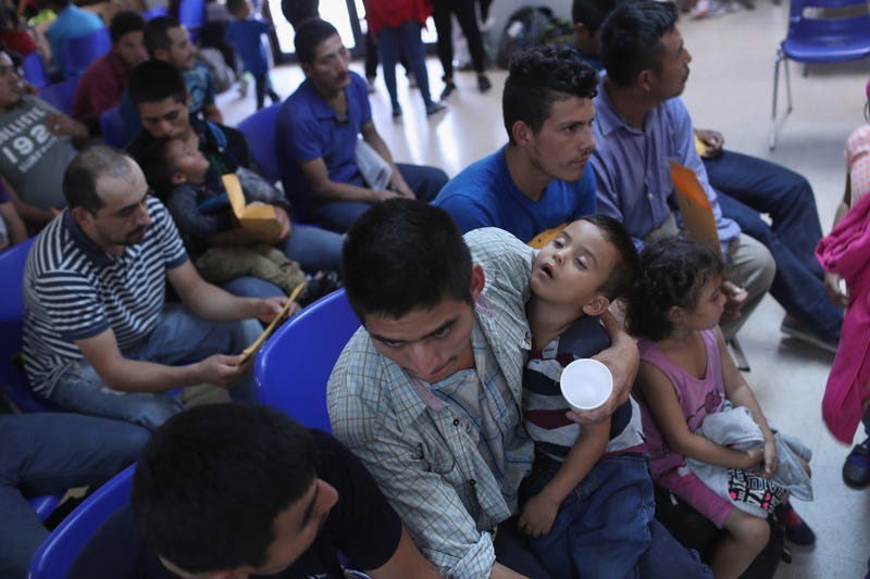 "Central American immigrant families take refuge at a Catholic Charities ""respite center"" after being released from ICE custody on June 11, 2018, in McAllen, Texas. Thousands of undocumented immigrants continue to cross into the U.S., despite the Trump administration's recent ""zero tolerance"" approach to immigration policy."
