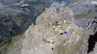 Video: Flying man in wing suit slices right through a hole in a mountain