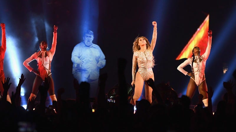 Beyonce on stage next to a hologram of John Candy.