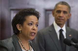 President Barack Obama looks on as his nominee for U.S. attorney general, Loretta Lynch, the U.S. Attorney in Brooklyn, N.Y., speaks during an event at the White House in Washington, D.C., Nov. 8, 2014.Jim Watson/AFP/Getty Images