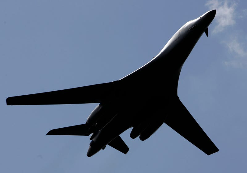 A United States Air Force B-1B bomber flies over during a flight display at the Farnborough aerospace show, in Farnborough, England, Tuesday July 15, 2008. The world's largest air show opened Monday with several new orders and aerospace executives upbeat about the future of the industry despite high fuel prices and the credit crisis. The Farnborough International Airshow on the outskirts of London is traditionally _ along with its sister show in Le Bourget in France on alternate years _ the scene of a flurry of high profile orders for U.S-based Boeing Co. and its European rival Airbus. (AP Photo/Lefteris Pitarakis)