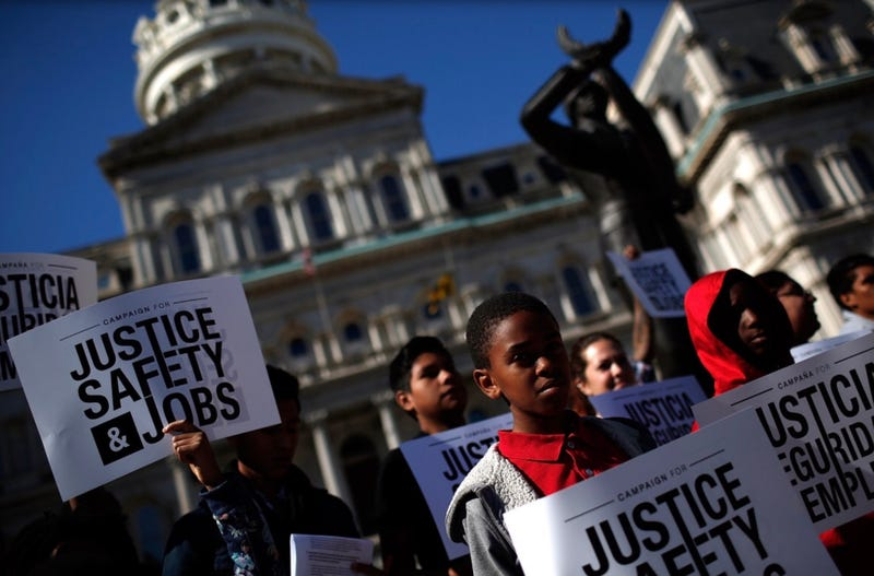 """Children from the Pleasant Hope Baptist Church attend a rally and news conference held by the Campaign for Justice, Safety and Jobs in Baltimore. During the rally, the advocacy group called for a """"six-point plan for police reform in Baltimore."""" (Win McNamee/Getty Images)"""