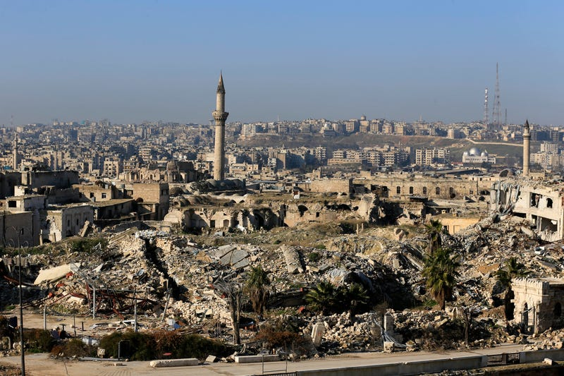 A general view shows the destruction of the luxurious Carlton Hotel who has been destroyed by insurgents on May 8, 2014, in the old city of Aleppo, Syria, Saturday, Jan. 21, 2017. Thousands of people have returned to their homes in east Aleppo that was held by rebels for more than four years until government forces took full control of it last month. East Aleppo has suffered wide destruction because of airstrikes and shelling. (AP Photo/Hassan Ammar)