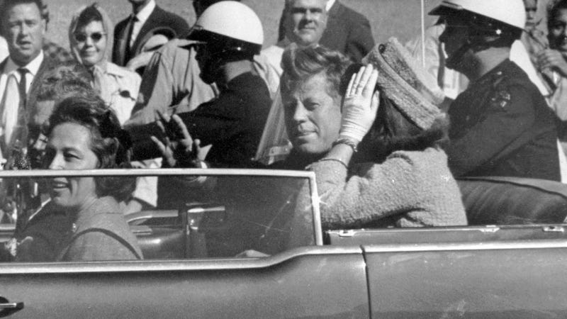 President John F. Kennedy approximately one minute before he was shot in Dallas. Image via AP.