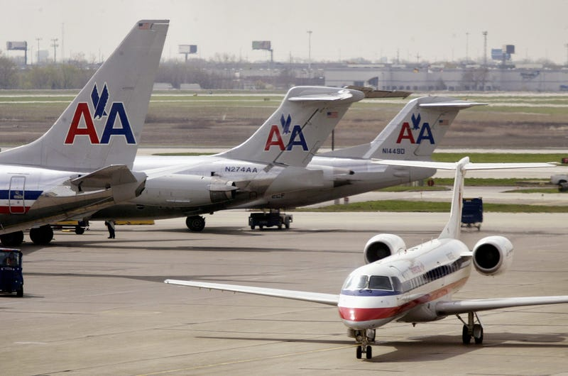 American Airlines jets sit on the tarmac as an American Eagle jet taxis to the gate at O'Hare International Airport April 25, 2003 in Chicago.