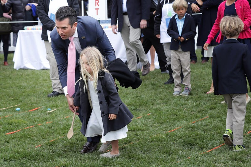 Donald Trump Jr. helps his daughter roll an egg during the 140th annual Easter Egg Roll on the South Lawn of the White House on April 2, 2018, in Washington, D.C.