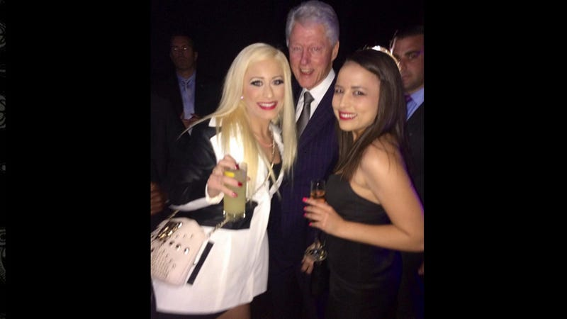 Illustration for article titled Bill Clinton Takes Photo With Sex Workers