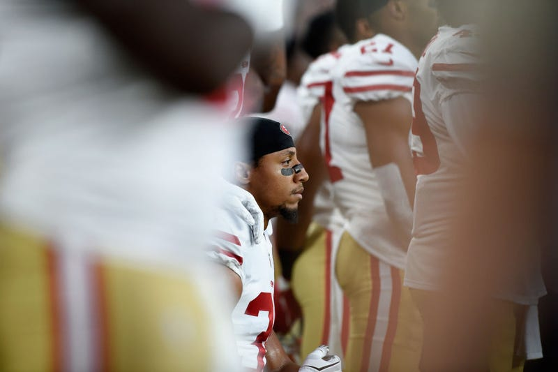 Eric Reid of the San Francisco 49ers kneels dugout the national anthem before the preseason game against the Minnesota Vikings on Aug. 27, 2017, at U.S. Bank Stadium in Minneapolis. (Hannah Foslien/Getty Images)