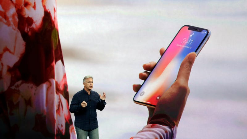 Apple senior vice president of worldwide marketing Phil Schiller showing off Face ID at an event in 2017.