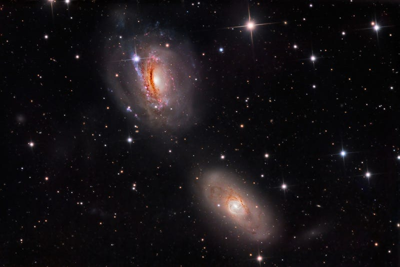 Two Beautiful Galaxies Are Pulling Each Other Apart