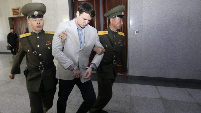 Warmbier is half-carried by North Korean officials into his trial. Image via AP.