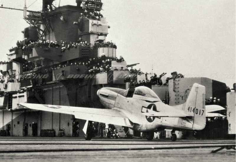 Sailors crowd the rails to watch US Navy test pilot Lieutenant Robert M. Elder operate the modified P-51D Mustang onboard the carrier USS Shangri-La in 1943 (Boeing)