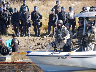 Law enforcement responds to protesters standing in the Cannonball River in North Dakota.Sacred Stone Camp via Facebook