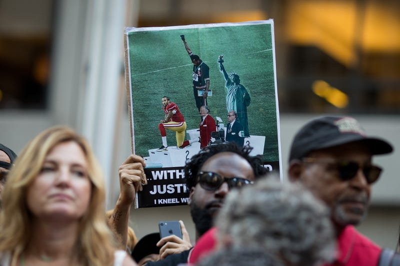 Activists rally in support of NFL quarterback Colin Kaepernick outside the offices of the National Football League on Aug. 23, 2017, in New York City. (Drew Angerer/Getty Images)