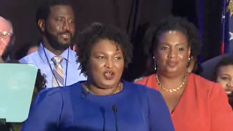 Jimmie Gardner (left) stands behind Georgia's Democratic nominee for governor, Stacey Abrams (center), and her sister, Judge Leslie J. Abrams (right), as they celebrate Stacey's victory May 22, 2018.