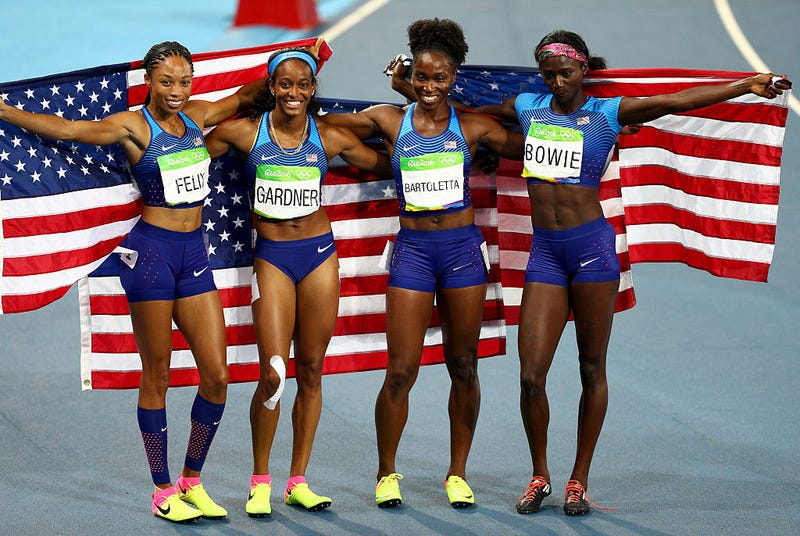 English Gardner, Allyson Felix, Tianna Bartoletta and Tori Bowie of the United States celebrate winning gold in the Women's 4x100-meter Relay Final on day 14 of the Rio 2016 Olympic Games at the Olympic Stadium in Rio de Janeiro.  Ian Walton/Getty Images