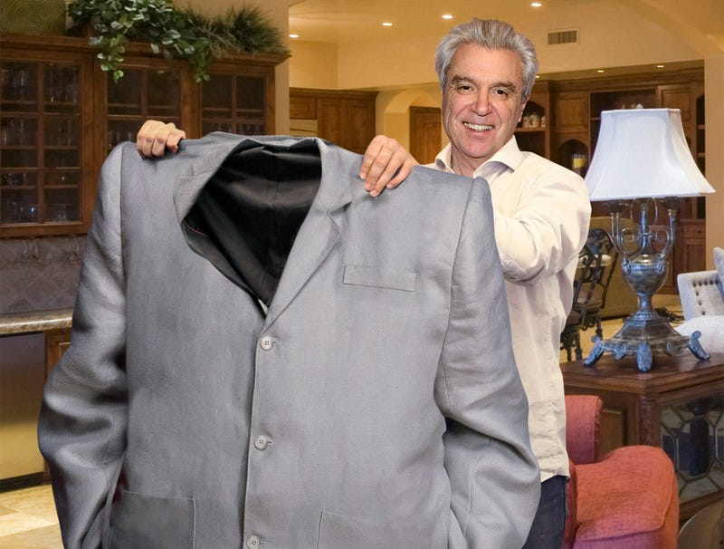 Illustration for article titled David Byrne Holds Up Old Suit To Show How Far He's Come In Weight Loss Journey