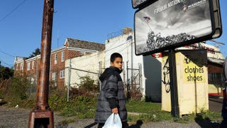 A child walks down a street in Camden, N.J., Oct. 11, 2012. According to the U.S. Census Bureau, Camden is the most impoverished city in the United States.Spencer Platt/Getty Images