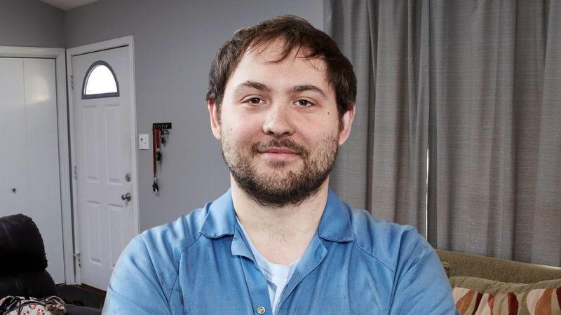 31-year-old Kevin Regan in his apartment.