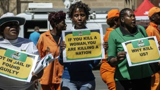 African National Congress Women League members demonstrate outside the High Court in Pretoria, South Africa, on Sept. 11, 2014, during the murder trial of double-amputee South African Olympic athlete Oscar Pistorius.GIANLUIGI GUERCIA/Getty Images