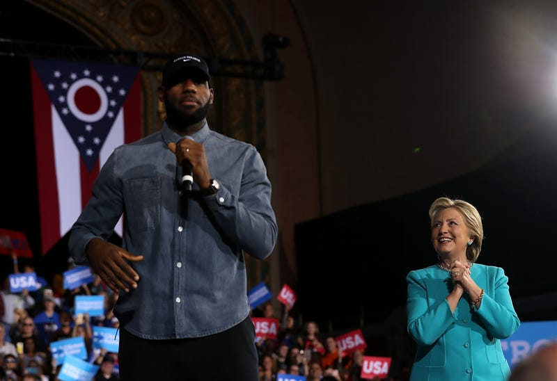 Then-Democratic presidential candidate Hillary Clinton looks on as LeBron James speaks during a campaign rally at the Cleveland Public Auditorium on Nov. 6, 2016.