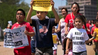 Young children join immigration-reform protesters while marching in front of the White House on July 7, 2014, in Washington, D.C.Win McNamee/Getty Images