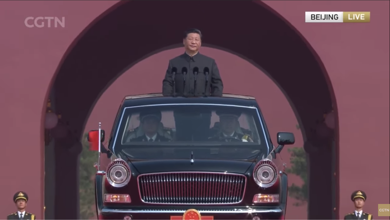 Chinese leader Xi Jinping rolling out to review the troops.