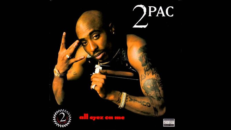 Illustration for article titled 20 years later, Tupac's All Eyez On Me is still as raw as an exposed nerve
