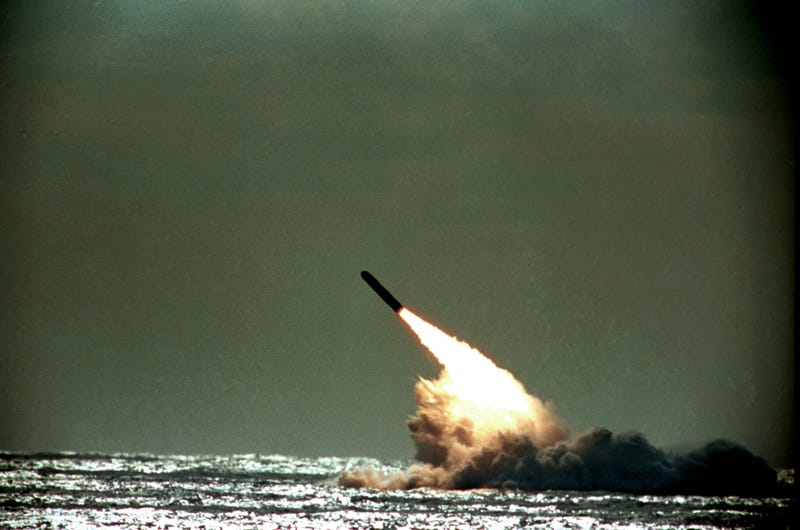 The U.S. Navy successfully launches a Trident II, D-5, Performance Evaluation Missile from the submerged submarine USS Tennessee in this 1989 file photo. The missile was launched despite attempts by the Greenpeace organization to stop the operation. (AP Photo/Phil Sandlin)