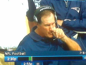 Illustration for article titled Here's a Picture of Bill Belichick Picking His Nose