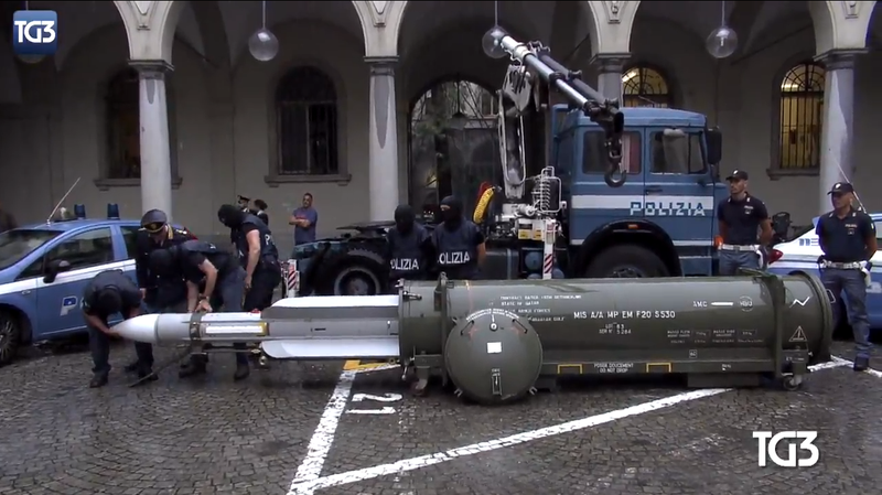 Italian authorities seizing a missile obtained by a neo-Nazi group, July 2019.