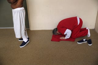 A Muslim immigrant detainee from Iran prays at the Adelanto Detention Facility on Nov. 15, 2013, in Adelanto, Calif. The Council of American-Islamic Relations in 2018 sued Washington state's Department of Corrections over its treatment of Muslim inmates during the Islamic holy month of Ramadan.