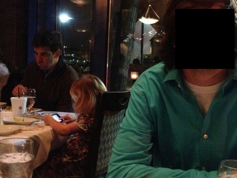 Illustration for article titled Eli Manning At A Restaurant, Looking At Something