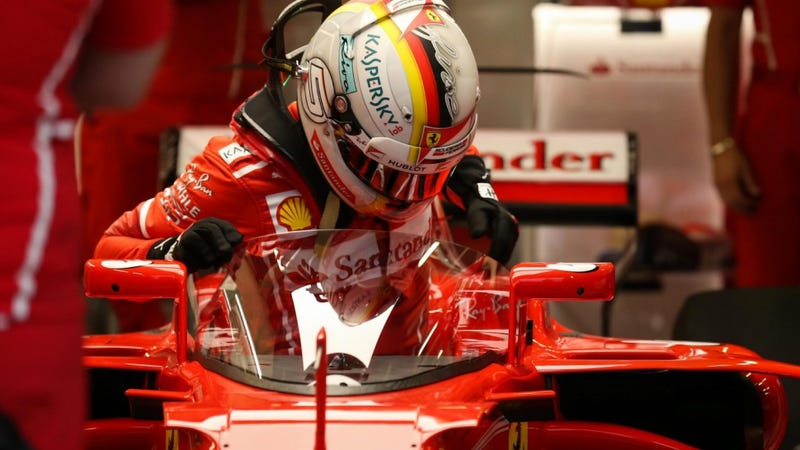 Vettel feels 'dizzy' behind new safety shield