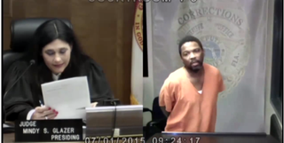 Judge Mindy Glazer with Arthur Booth in Miami-Dade Circuit Court July 2, 2015Screenshot